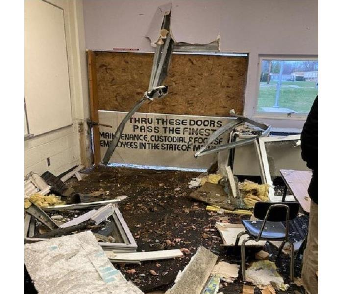Car crashes into school room.